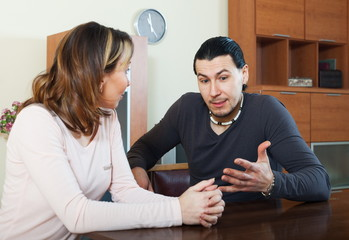 Adult man with wife talking