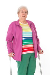 female senior with crutches