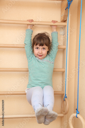 Little girl climbing