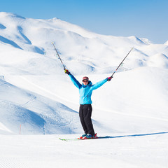 Excited woman skier.