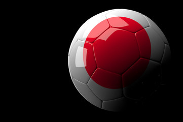 Japan soccer ball on dark background