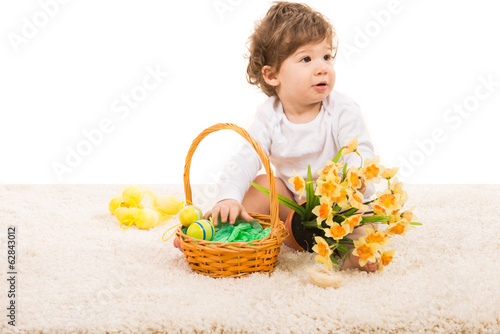 Boy with Easter basket looking away
