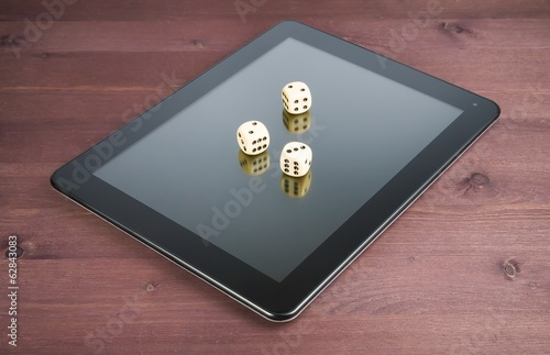 three dice on digital tablet pc, concept of texas game online