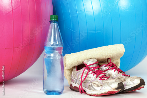 Exercise balls with sneakers and a water bottle