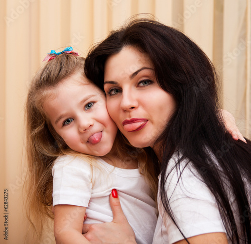 Mother and daughter having fun at home.
