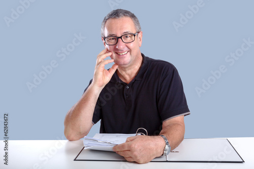 Man at desk with file folders