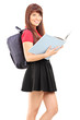Female student with backpack holding a book