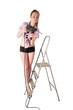 Woman with puncher on ladder