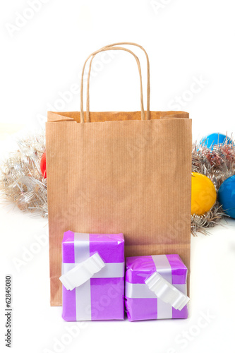 Two gift boxes with a brown paper shopping bag