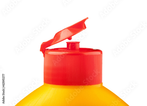 Red cup on yellow bottle