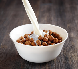 Bowl of chocolate cereal on a table