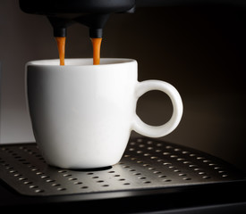 Coffee machine pouring a cup of espresso