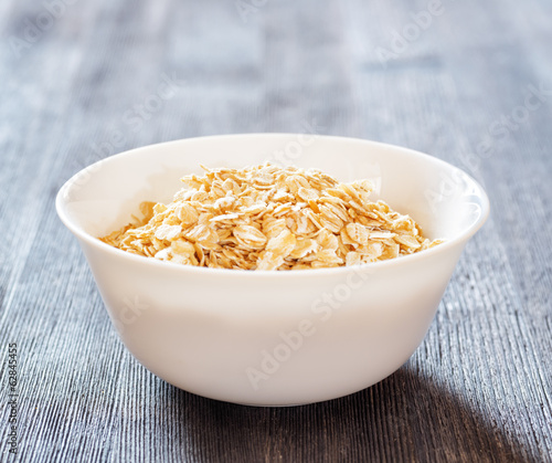 Bowl of oatmeal on wooden table