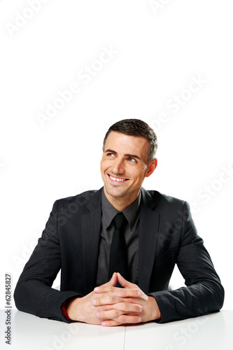 Cheerful businessman sitting at the table