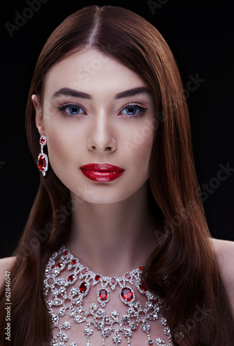 high fashion portrait of beautiful brunette woman wearing jewell