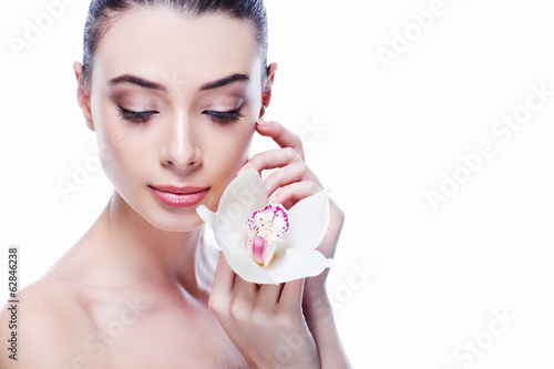 Beauty Girl With Orchid Flower.Beautiful Model Woman Face.