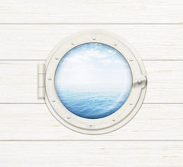 ship window or porthole on wooden wall with sea or ocean visible