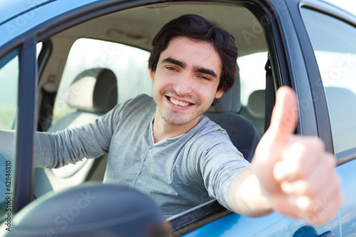 canvas print picture Portrait of an attractive man in his car