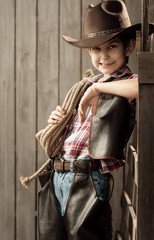 Portrait of a boy dressed as a cowboy