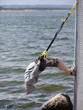 man outdoor,suspension training at the sea