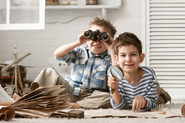 Boys in images traveler studying maps and old books