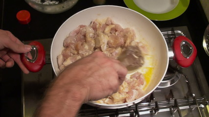 Cooking chicken with orange sauce