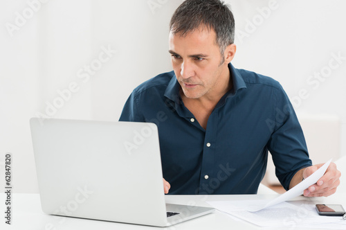 Mature Man Working At The Computer