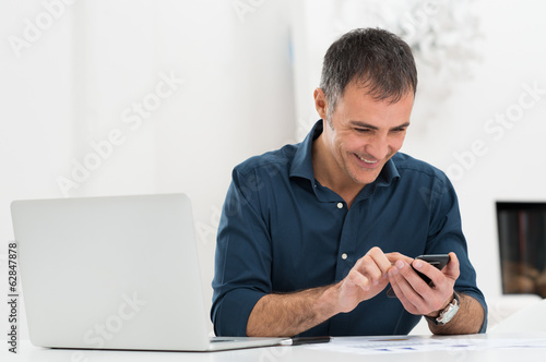 Happy  Mature Man Using Cellphone