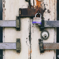 Close up of a padlocked and bolted door.