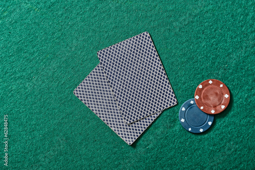 cards and chips on a green felt