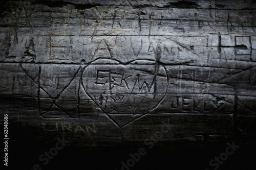 A heart shape carved into seasoned timber, with a romantic message.