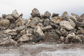 A large pile of rocks used for road construction.