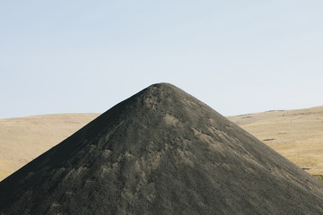Large gravel pile used for road construction and maintenance