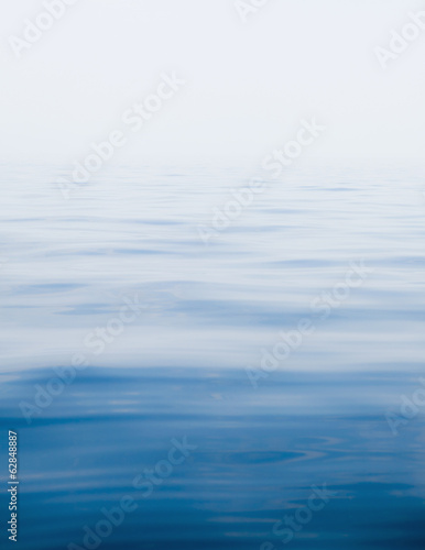 A view across the water surface of a lake near McBride Glacier, in Glacier Bay national park.