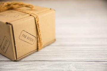 cardboard box isolated on white wood background