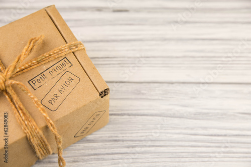 cardboard box isolated on white wood background