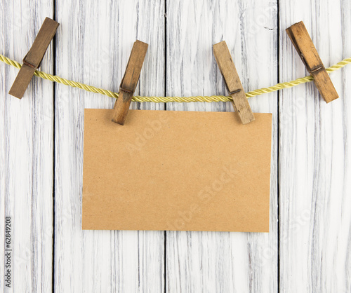 Paper nameplate on old wood background