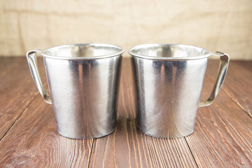 Old cup and bowl from stainless steel