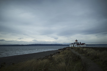 The lighthouse at dusk at Discovery Park in Seattle, WA.