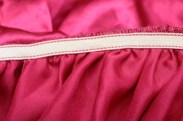 Macro of elastic and pink fabric