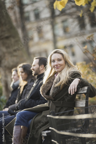 Business people on bench in urban park