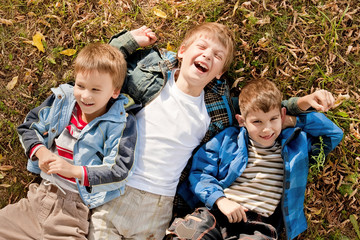 Portraits of the boys lying on the grass