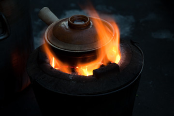 Pot simmering on a small barbeque, Yangon, Myanmar