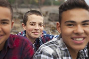 A day out at Ashokan lake. Three boys on the shore.