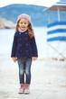 Child walking near the sea