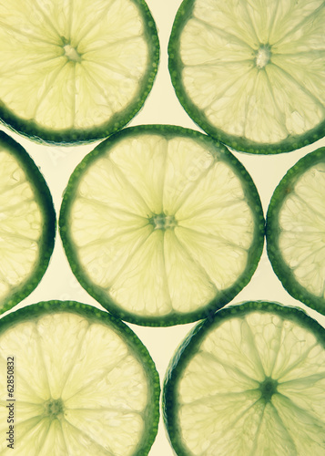 Organic lime slices on white background