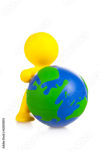 toy little man rolls forward globe.