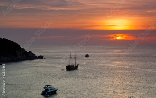 Yachts and boats in calm Andaman Sea sunset, Thailand © Shchipkova Elena