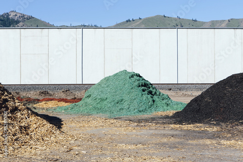 Piles of green bark wood chips used for landscaping, near Quincy