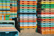 Stacks of multi-colored containers used for harvesting grapes
